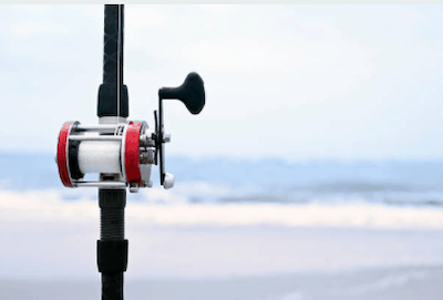 Photo of surf casting reel attached to rod