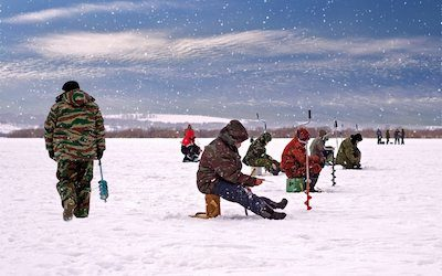 How far apart should ice fishing holes be?